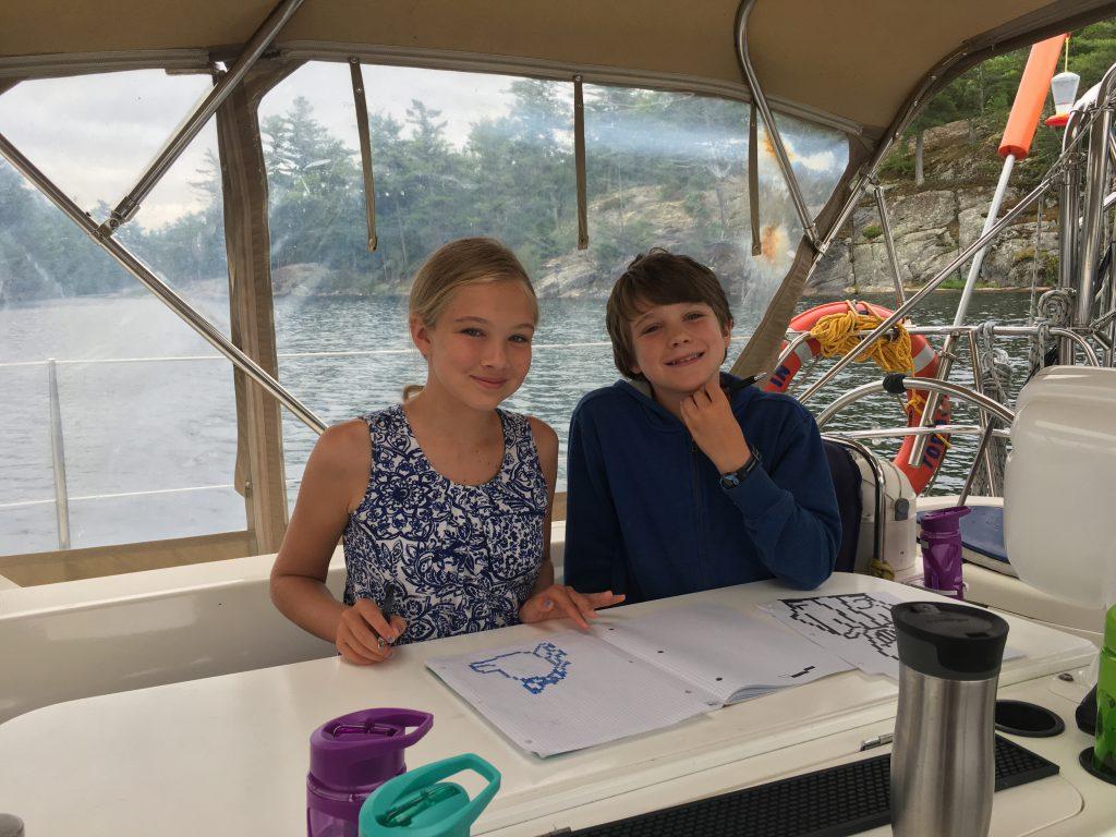 Kids colouring on the sailboat